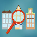 Real-estate concept with magnifying glass. Royalty Free Stock Photography