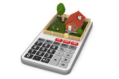 Real Estate Concept. Small House with Fence and Garden over Calc. Ulator on a white background. 3d Rendering Stock Photo