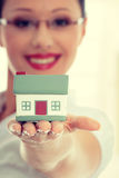 Real estate concept. Young beautiful business woman with house model - real estate concept royalty free stock image