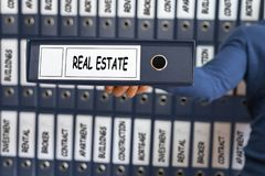 Real Estate concept. Young man holding ring binder. Business concept Stock Photos