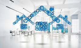 Real estate or construction idea presented by home icon on white office background. Conceptual background image with house sign made of connected gears. 3d Royalty Free Stock Photos
