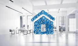 Real estate or construction idea presented by home icon on white office background. Conceptual background image with house sign made of connected gears. 3d Stock Photos