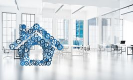 Real estate or construction idea presented by home icon on white office background. Conceptual background image with house sign made of connected gears. 3d Stock Images
