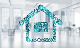 Real estate or construction idea presented by home icon on white office background. Conceptual background image with house sign made of connected gears. 3d Royalty Free Stock Image