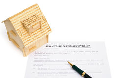 Real estate contact and an architectural model Stock Photo