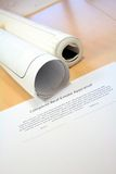 Real Estate Contract and Blueprints. On Work Desk Royalty Free Stock Photo