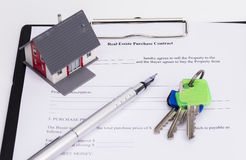 Real estate contract. With house, pen and keys,  on white background Royalty Free Stock Photography