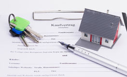 Real estate contract. With house, pen and keys,  on white background Stock Photo