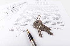 Real estate contract. With keys (random latin dummy text used Royalty Free Stock Photography
