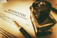 Real Estate Contract of Sale. Residential Real Estate Contract of Sale. Vintage Sepia Color Grading Concept Stock Photos