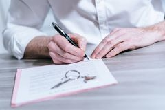 Real estate contract signature (Lorem ipsum text used). Signature of a real estate contract (Lorem ipsum text used royalty free stock photos