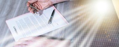 Real estate contract signature (lorem ipsum text used); multiple. Signature of a real estate contract (lorem ipsum text used); multiple exposure stock photography
