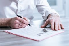 Real estate contract signature (Lorem ipsum text used). Signature of a real estate contract (Lorem ipsum text used stock photos