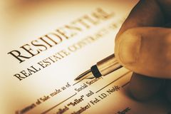 Real Estate Contract. Signing Residential Real Estate Contract Closeup Photo. Real Estate Business Concept Royalty Free Stock Photography
