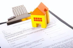 Real estate contract. With a small house toy stock photo