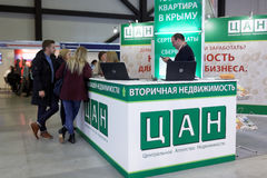 Real Estate Fair in St. Petersburg, Russia. St. Petersburg, Russia - October 31, 2015: Visitors at the desk of real estate resale agency CAN in the Expoforum royalty free stock image