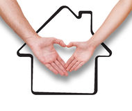 Real estate, family and couple concept Couple making heart shape made with their fingers. Drawing house as background Stock Photo