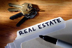 Real Estate File Folder with Marker and House Keys Royalty Free Stock Photos