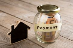 Real estate finance concept - money glass with Payment word stock photos