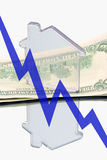 Real estate and finance (down). Real estate and finance (Model of house is standing on the money Stock Photography