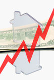 Real estate and finance (up). Real estate and finance (Model of house is standing on the money Stock Photo