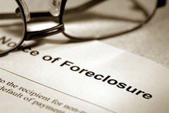Real Estate Foreclosure Notice and Glasses Royalty Free Stock Photography