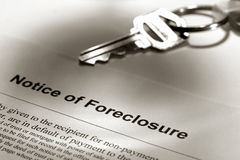 Real Estate Foreclosure Notice and House Key stock images