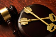 Real estate fraud. Gavel and keys. Real estate fraud concept. Gavel and keys stock photo