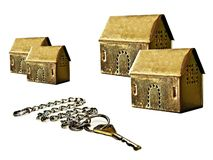 Real estate: gold. Key and four houses stock photography