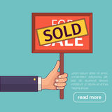 Real estate. Hand holding sold sign. Royalty Free Stock Photography