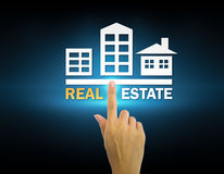 Real estate. Hand and real estate sign with dark background Royalty Free Stock Photos