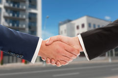 Real estate handshake over new buildings background Stock Images