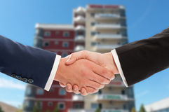 Real estate handshake over office building background Royalty Free Stock Photos