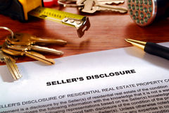 Real Estate Home Owner Seller Disclosure Statement. Real estate homeowner seller property disclosure condition statement with house keys and inspection Royalty Free Stock Images
