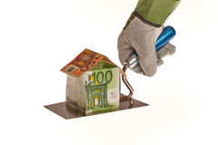 Real estate. House constructions costs through money on a workers trowel royalty free stock photo
