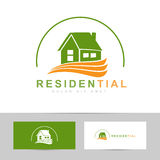 Real estate house green orange logo Stock Photo