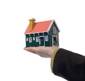 Real estate - house in hand. Miniature house in woman hand - isolated - real estate concept Stock Images