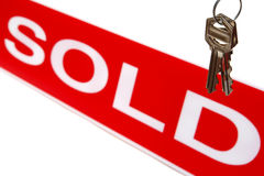 Real Estate House Keys and Realtor Sold Sign. Real Estate agent sold sign Realtor advertising banner and house keys over white stock photography