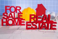 Real estate with house model and achitectural drawing Royalty Free Stock Image