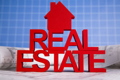 Real estate with house model and achitectural drawing Royalty Free Stock Photography