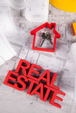 Real estate with house model and achitectural drawing Royalty Free Stock Photo