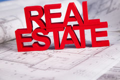 Real estate with house model. Commercial Real Estate and Architectural project Stock Photos