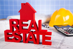 Real estate with house model. Commercial Real Estate and Architectural project Royalty Free Stock Image