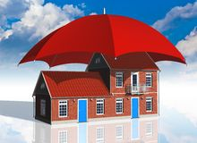 Real estate insurance concept. Residential house covered by red umbrella Stock Image