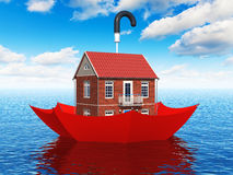 Real estate insurance concept. Creative real estate security, home protection and insurance business concept: residential house cottage floating in blue sea Royalty Free Stock Image