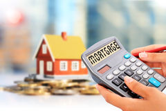 Real estate investment. Loan calculator and house. Real estate investment Royalty Free Stock Photography