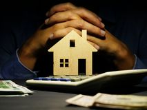 Real estate investment or mortgage. Model of home on the table stock photography