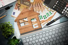 Real estate investments - House Model and banknotes royalty free stock photography