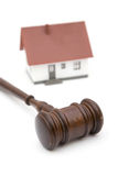 Real estate and laws. Concept for real estate laws with a house and gavel on white, shallow dof royalty free stock image