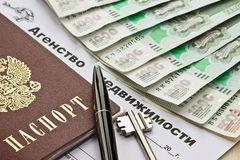 Real estate lease agreement with a passport and keys. Real estate lease agreement with a passport, keys and pen Royalty Free Stock Photo